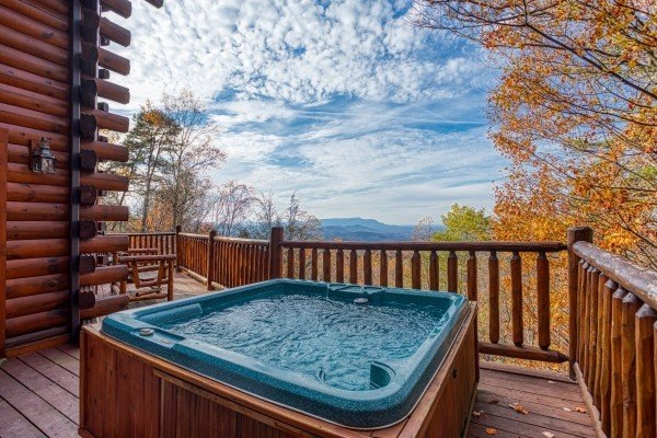 Hot tub on a deck with a mountain view at The Original American Dream, a 2 bedroom cabin rental located in Gatlinburg