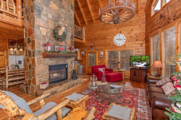 Living room with a stone fireplace at The Original American Dream, a 2 bedroom cabin rental located in Gatlinburg