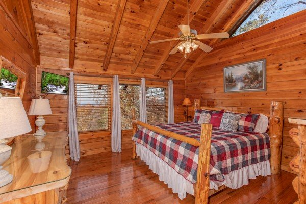 Custom log bed in a loft bedroom at The Original American Dream, a 2 bedroom cabin rental located in Gatlinburg