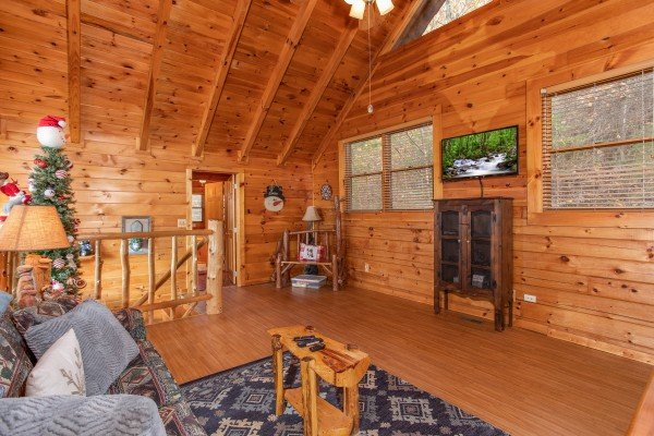 Seating area with television in the loft at The Original American Dream, a 2 bedroom cabin rental located in Gatlinburg