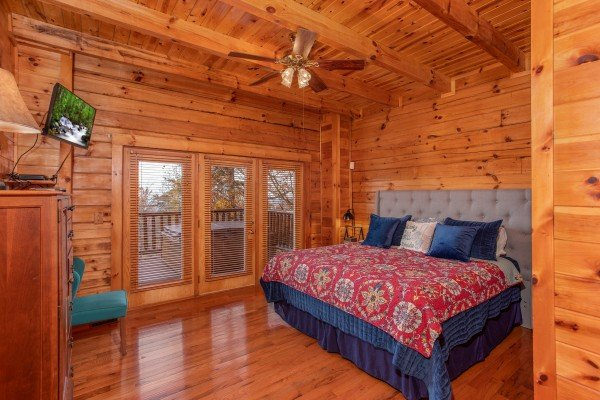 Master bedroom with wall mounted television at The Original American Dream, a 2 bedroom cabin rental located in Gatlinburg