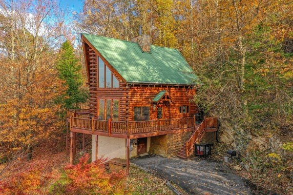 Side exterior view with parking at The Original American Dream, a 2 bedroom cabin rental located in Gatlinburg