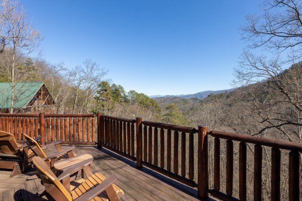 Adirondack chairs on a deck at Hatcher Mountain Retreat a 2 bedroom cabin rental located in Pigeon Forge
