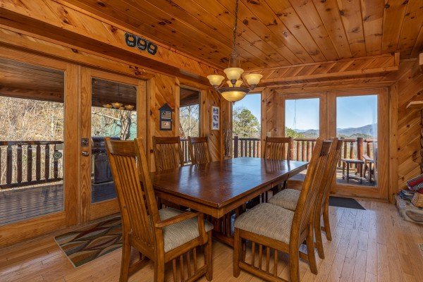 Dining table for six at Hatcher Mountain Retreat a 2 bedroom cabin rental located in Pigeon Forge