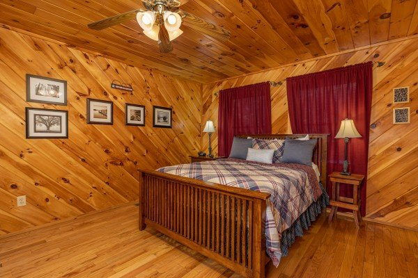 Bedroom with bed, two night stands, and lamps at Hatcher Mountain Retreat a 2 bedroom cabin rental located in Pigeon Forge