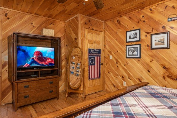 TV and armoir in a bedroom at Hatcher Mountain Retreat a 2 bedroom cabin rental located in Pigeon Forge