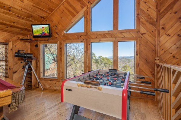 Foosball table at Hatcher Mountain Retreat a 2 bedroom cabin rental located in Pigeon Forge