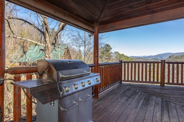 Gas grill on a covered deck at Hatcher Mountain Retreat a 2 bedroom cabin rental located in Pigeon Forge