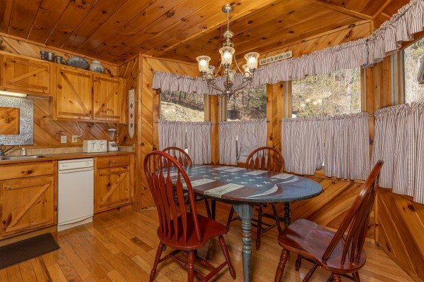 Kitchen table at Hatcher Mountain Retreat a 2 bedroom cabin rental located in Pigeon Forge