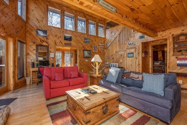 Sofa and loveseat in a living room at Hatcher Mountain Retreat a 2 bedroom cabin rental located in Pigeon Forge