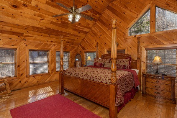 Four post bed with night stands and lamps in the loft at Hatcher Mountain Retreat a 2 bedroom cabin rental located in Pigeon Forge