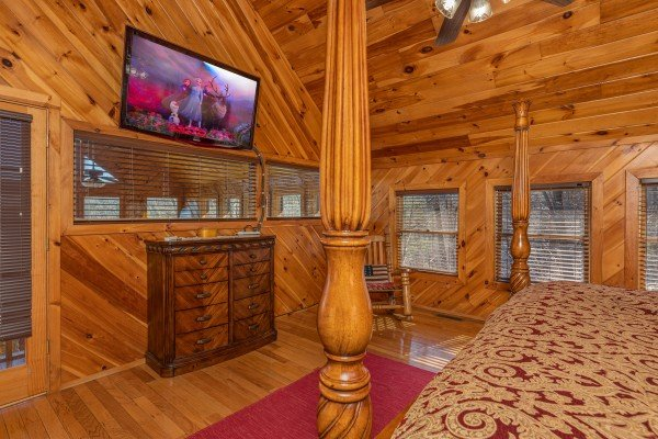 Dresser and TV in a bedroom at Hatcher Mountain Retreat a 2 bedroom cabin rental located in Pigeon Forge