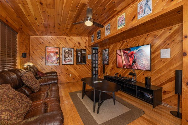 Lower level living room with seating and TV at Hatcher Mountain Retreat a 2 bedroom cabin rental located in Pigeon Forge