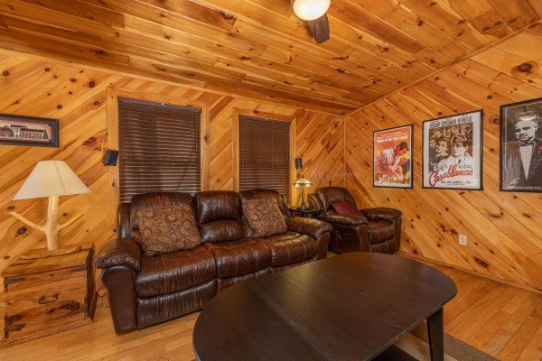 Seating in the lower living room at Hatcher Mountain Retreat a 2 bedroom cabin rental located in Pigeon Forge
