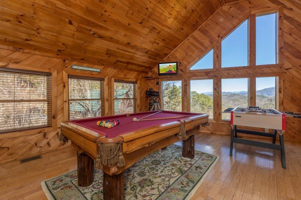 Pool table in the loft at Hatcher Mountain Retreat a 2 bedroom cabin rental located in Pigeon Forge