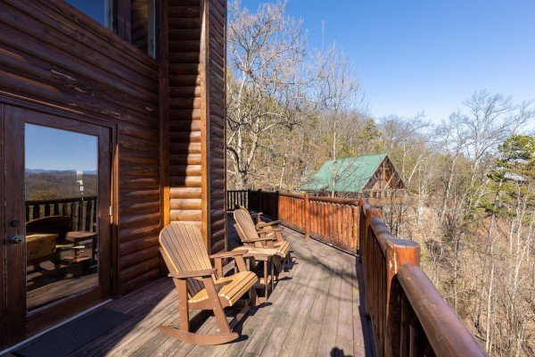 Rocking chairs on a deck at Hatcher Mountain Retreat a 2 bedroom cabin rental located in Pigeon Forge