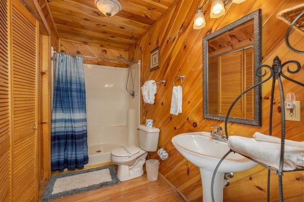 Bathroom with tub and shower at Hatcher Mountain Retreat a 2 bedroom cabin rental located in Pigeon Forge