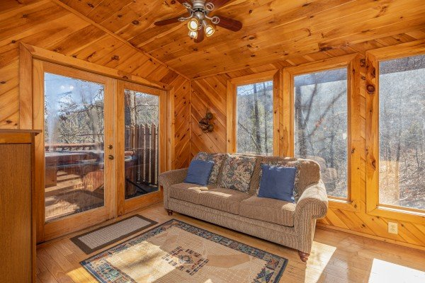 Sitting room with sofa at Hatcher Mountain Retreat a 2 bedroom cabin rental located in Pigeon Forge