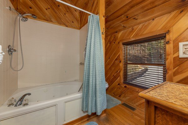 Bathroom with a shower and jacuzzi at Hatcher Mountain Retreat a 2 bedroom cabin rental located in Pigeon Forge