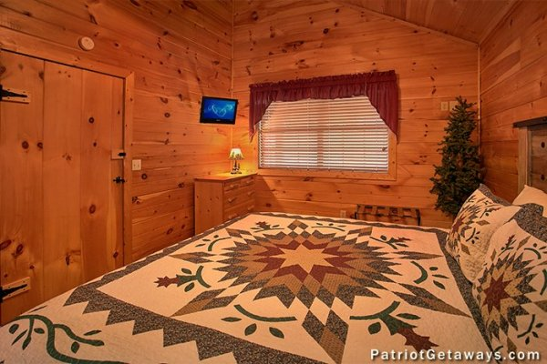 Bedroom with dresser and television at A Getaway with a View, a 2 bedroom cabin rental located in Pigeon Forge