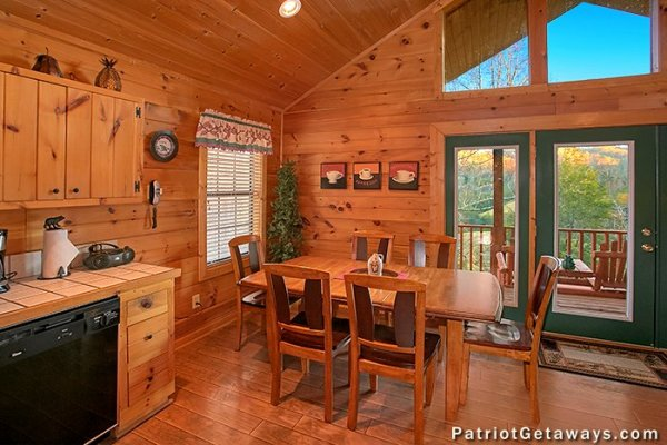 Dining room with deck view at A Getaway with a View, a 2 bedroom cabin rental located in Pigeon Forge