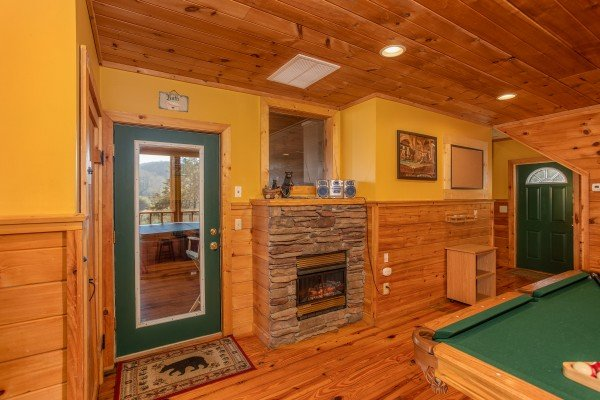 Fireplace in the game room at A Getaway with a View, a 2 bedroom cabin rental located in Pigeon Forge