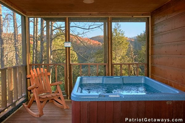 Hot tub on a porch at A Getaway with a View, a 2 bedroom cabin rental located in Pigeon Forge
