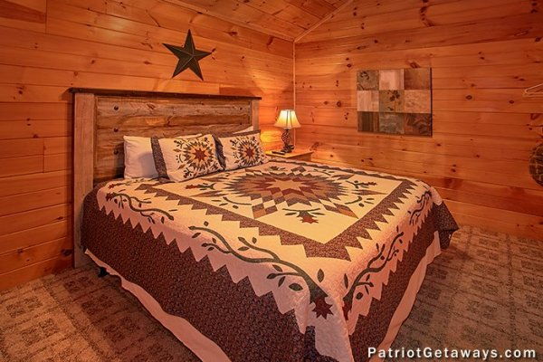 King sized bed at A Getaway with a View, a 2 bedroom cabin rental located in Pigeon Forge