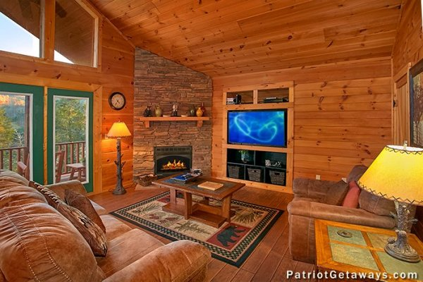 Living room with fireplace and television at A Getaway with a View, a 2 bedroom cabin rental located in Pigeon Forge