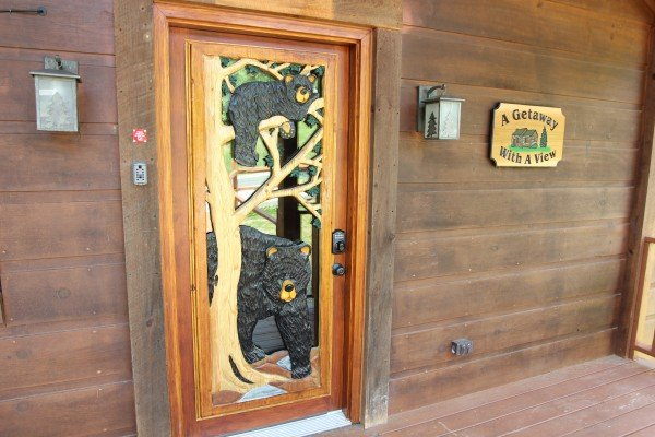 Custom bear themed front door at A Getaway with a View, a 2 bedroom cabin rental located in Pigeon Forge