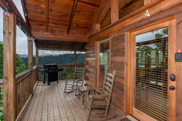Covered deck with a propane grill at Knotty Nest, a 1 bedroom cabin rental located in Pigeon Forge