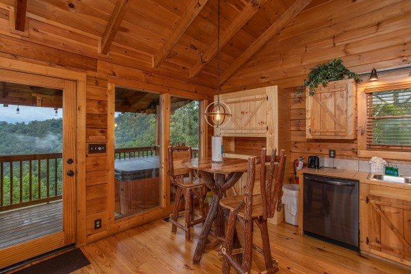 Dining table for two in the kitchen at Knotty Nest, a 1 bedroom cabin rental located in Pigeon Forge