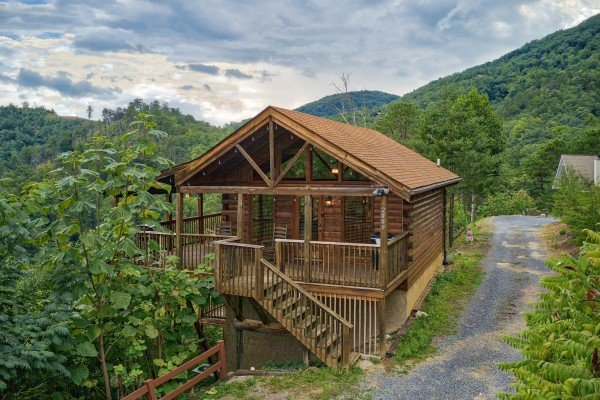 Exterior view of the cabin and driveway at Knotty Nest, a 1 bedroom cabin rental located in Pigeon Forge