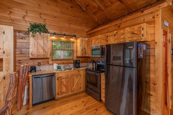Kitchen with slate gray appliances at Knotty Nest, a 1 bedroom cabin rental located in Pigeon Forge