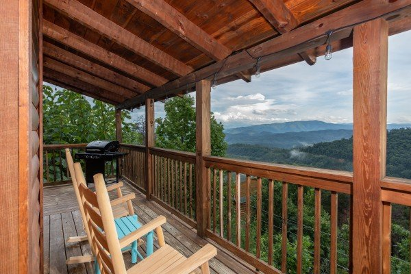 Rocking chairs on the covered deck overlooking the mountains at Knotty Nest, a 1 bedroom cabin rental located in Pigeon Forge