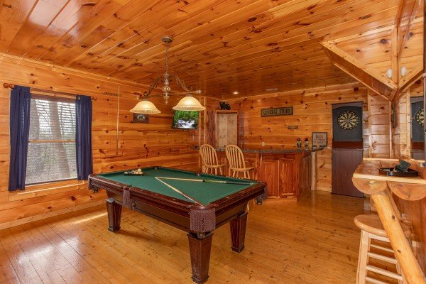 Game room with pool table, darts, and a wet bar at Altitude Adjustment, a 1 bedroom cabin rental located in Pigeon Forge