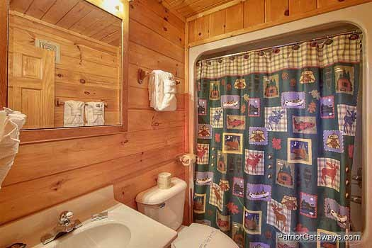 Bathroom with shower and jacuzzi tub combination at Fishin' Hole, a 1-bedroom cabin rental located in Gatlinburg
