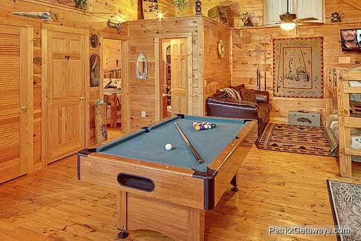 Pool table with green felt at Fishin' Hole, a 1-bedroom cabin rental located in Gatlinburg