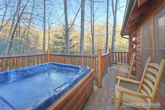 hot tub on deck at fishin' hole a 1 bedroom cabin rental located in gatlinburg