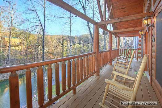 Rocking chairs on the deck at Fishin' Hole, a 1-bedroom cabin rental located in Gatlinburg