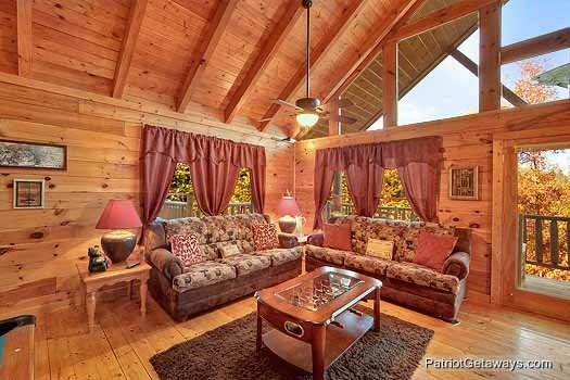 Two sofa beds in the living room at Fishin' Hole, a 1-bedroom cabin rental located in Gatlinburg