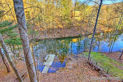 Looking down at the dock on the river from the deck at Fishin' Hole, a 1-bedroom cabin rental located in Gatlinburg