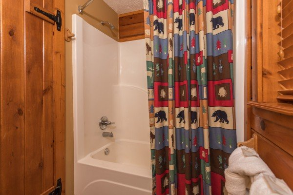 Bathroom with a tub and shower at Ridge View, a 1 bedroom cabin rental located in Pigeon Forge
