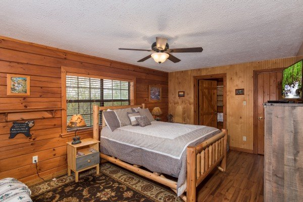 Queen size log bed at Ridge View, a 1 bedroom cabin rental located in Pigeon Forge
