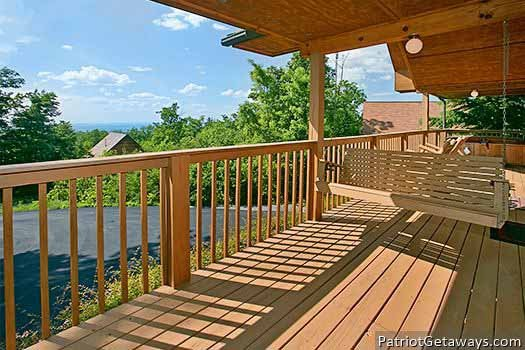 deck with porch swing at ridge view a 1 bedroom cabin rental located in pigeon forge