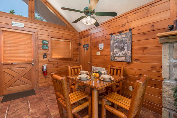 Dining room with seating for four at Ridge View, a 1 bedroom cabin rental located in Pigeon Forge