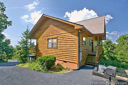 exterior view with grill at ridge view a 1 bedroom cabin rental located in pigeon forge
