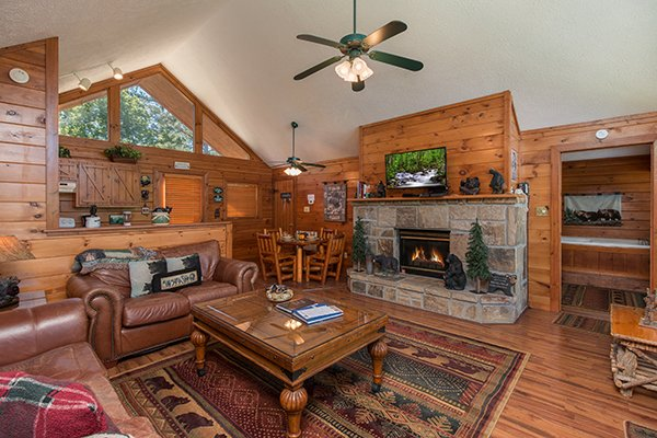 Living room with a fireplace and TV at Ridge View, a 1 bedroom cabin rental located in Pigeon Forge