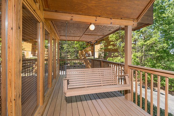 Swing on a covered porch at Ridge View, a 1 bedroom cabin rental located in Pigeon Forge