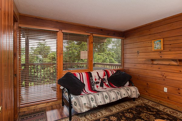 Futon in the queen bedroom at Ridge View, a 1 bedroom cabin rental located in Pigeon Forge